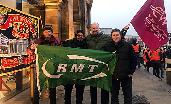 Pic: Carfl Webb with CWU members in support at Lime Street Station